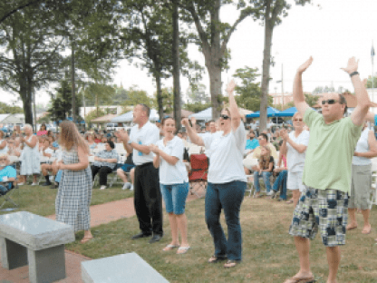 Benson's Singing Grove will be filled with enthusiastic crowds this weekend for the town's 96th State Annual Singing Convention, which kicks off Friday evening with a special 'Singspiration' concert. Pictured, a particularly lively crowd from a past event enjoys the gospel music. Photo and story courtesy The Dunn Daily Record