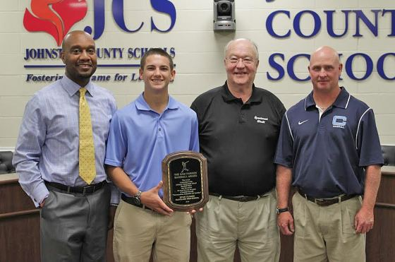 Cleveland High senior Ryan Flores (second from left) accepts the 2016 Sam Narron Baseball Award. Standing with him (from left) are Cleveland High Principal Kendrick Byrd, Rooster Narron and Coach Jamie Lee.