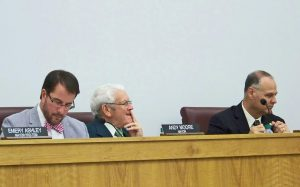 Interim Town Manager Jim Freeman (center) stayed on the job an additional 10 weeks after the hiring of new town manager Michael Scott (right) at the request of Mayor Andy Moore (left) and members of the Smithfield Town Council. The decision cost taxpayers an extra $20,804. JoCoReport.com Photo