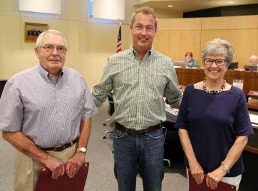 From left to right: Hubert Schmidt, Mayor McLeod, and Judith Schmidt
