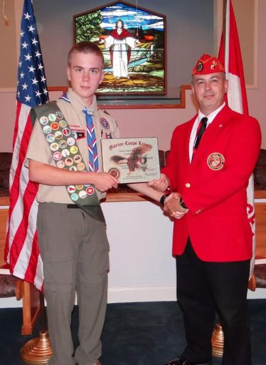 (Left to right) Jesse Stephenson from Boy Scout Troop #421 in Archer Lodge receives the Eagle Scout Good Citizenship Award from Lewis Rice III of the Johnston County Marine Corps League Carry-On Detachment #1236 during a special ceremony on Sunday at Amelia Christian Church in Clayton.