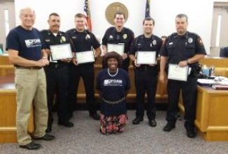 Members of the Four Oaks Area Ministries organization recognize the Four Oaks Police Department with Certificates of Recognition. JoCoReport.com Photo