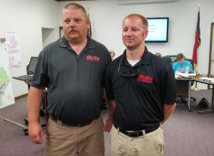 (Left to right) Selma Fire Chief Philip McDaniel introduces firefighter Ben Meyer to members of the Selma Town Council. JoCoReport.com Photo