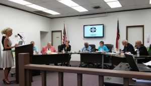 Selma Town Planning Director Julie Maybee (far left) discusses the Andrew's Way subdivision with members of the Selma Town Council at their August monthly meeting. The council voted 5-to-0 to approve the subdivision. JoCoReport.com Photo