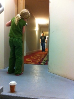 Girl in hotel hallway