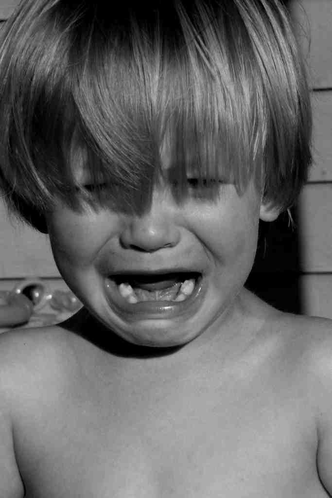 child crying black and white