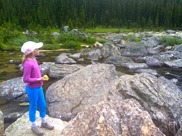 Girl standing on rocks in a stream