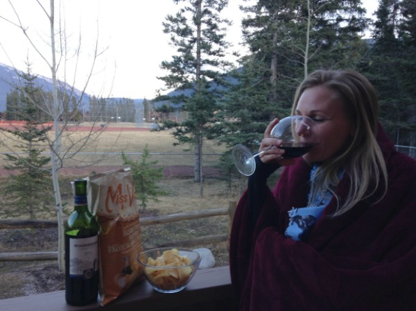 Woman drinking red wine outside