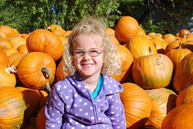 children in pumpkin patch