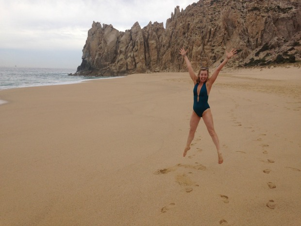 woman-jumping-on-beach