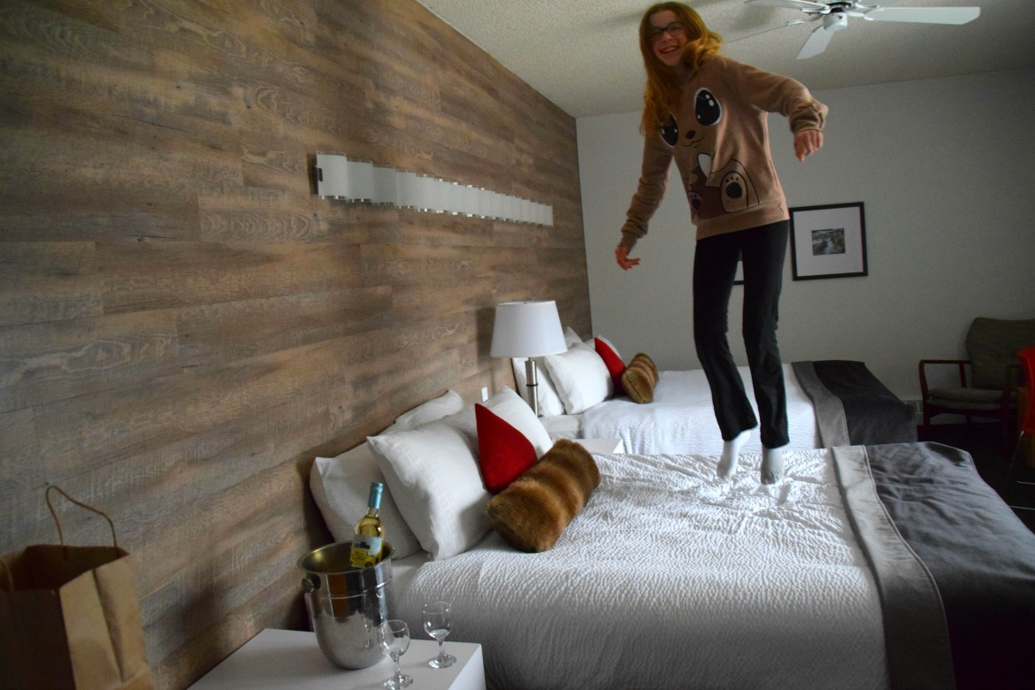 tween girl jumping on bed
