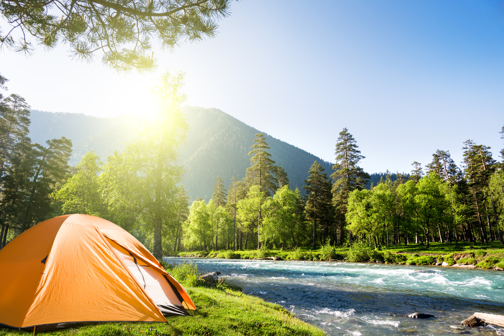 camping by a river in summer