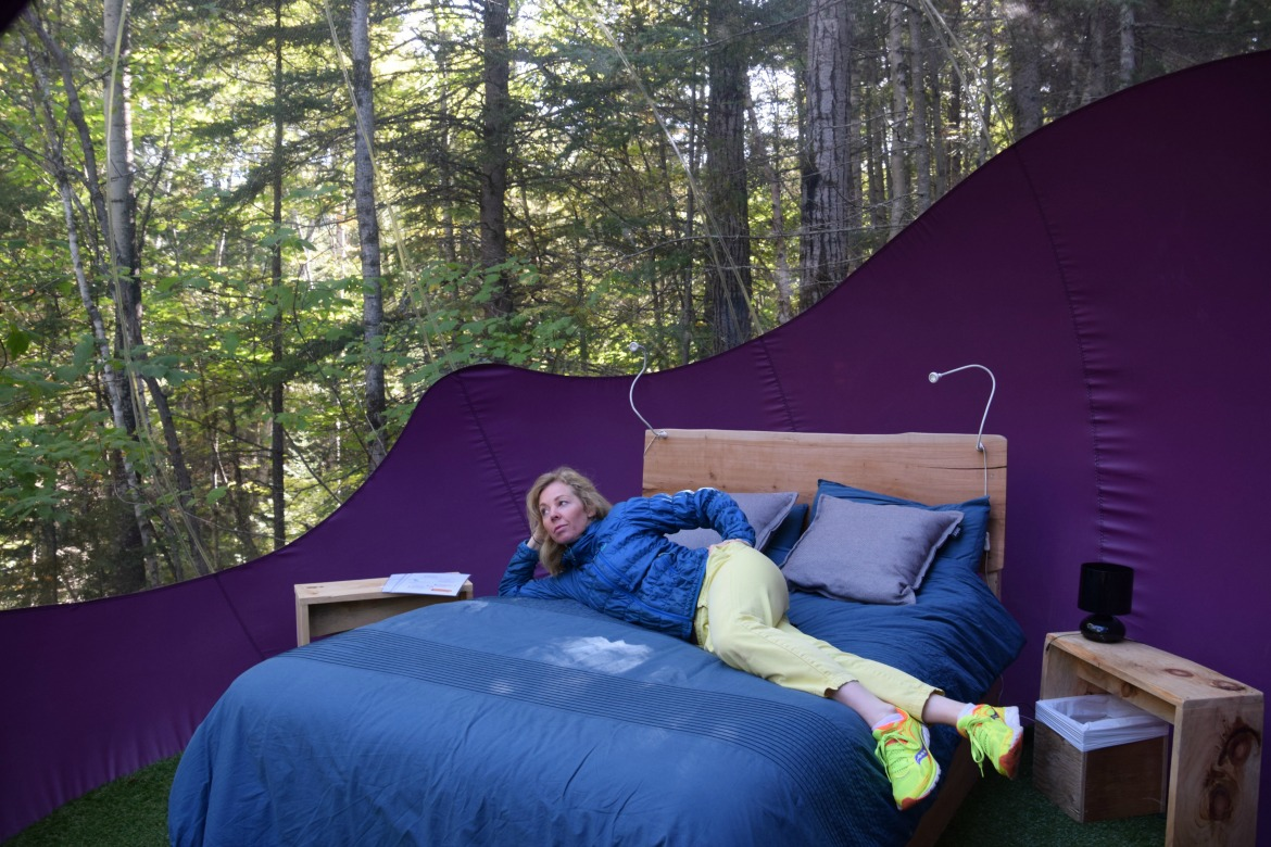 woman inside glamping tent