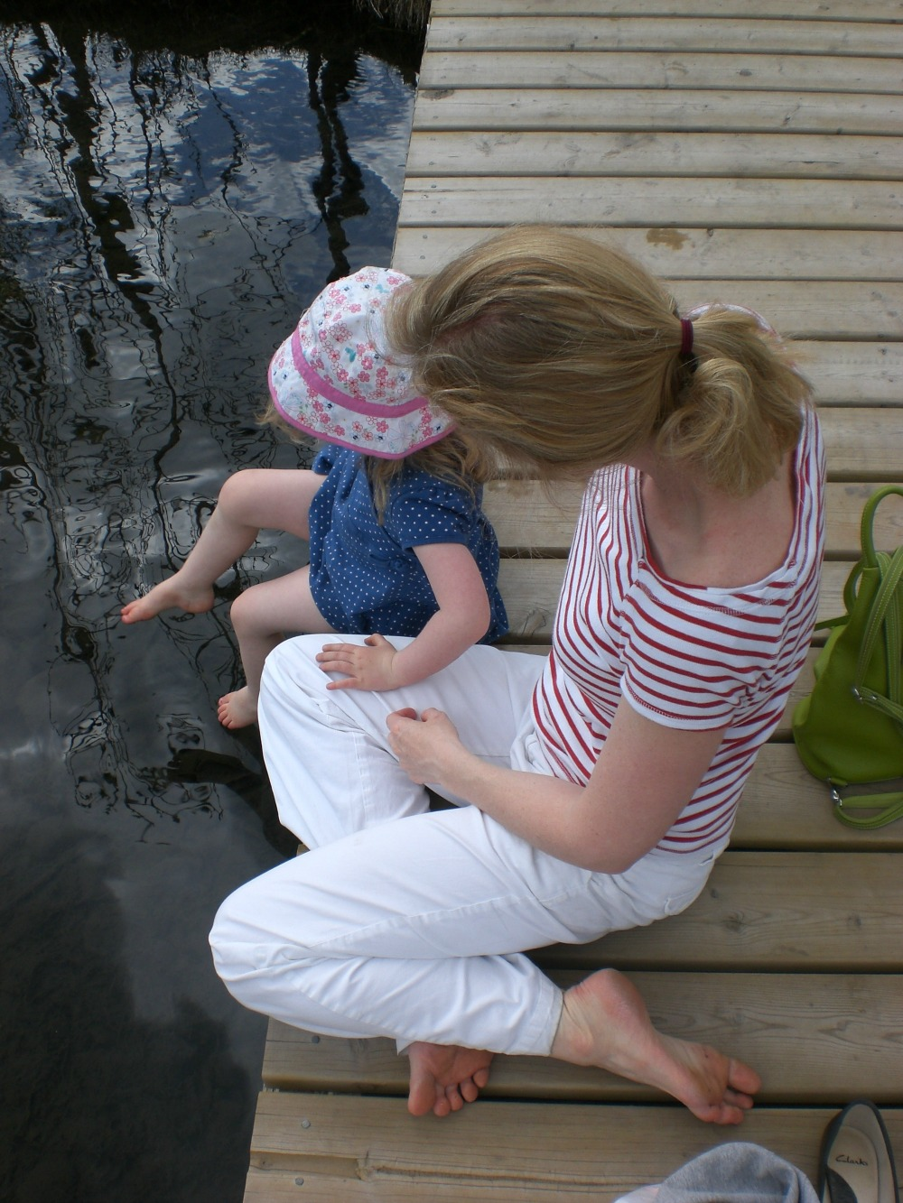 mom and daughter on a dock