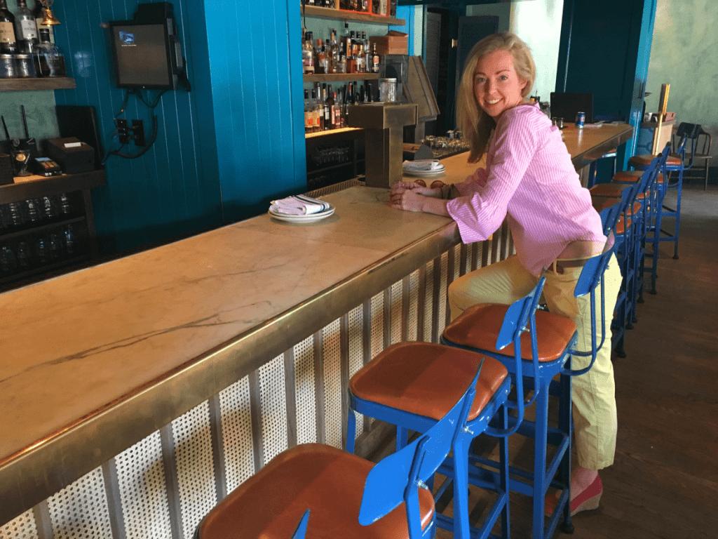 Blonde at tiki bar