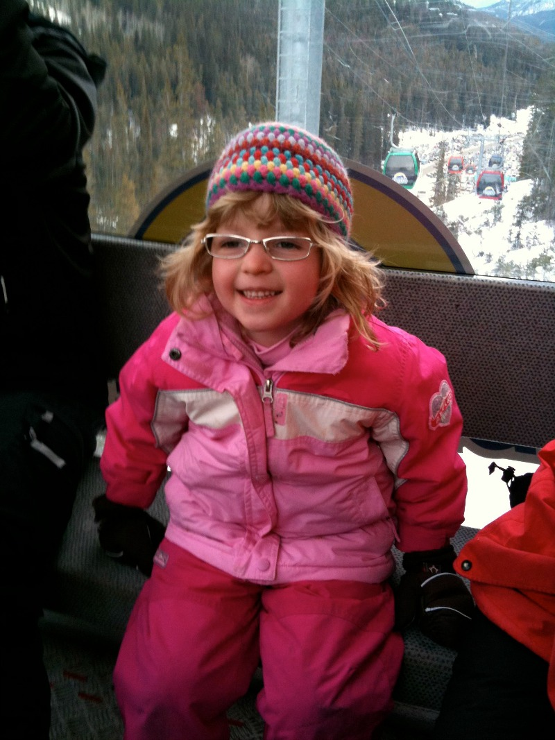 girl taking gondola in winter