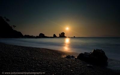 Een zonsondergang met een big stopper op Playa Silencio.