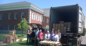 RHB Staff Loading Books for Ghana