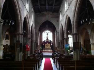 Interior: Since Hildersham's time, some aisles have been added and the pews replaced. Hildersham is buried in the chancel, toward the top of the photograph.