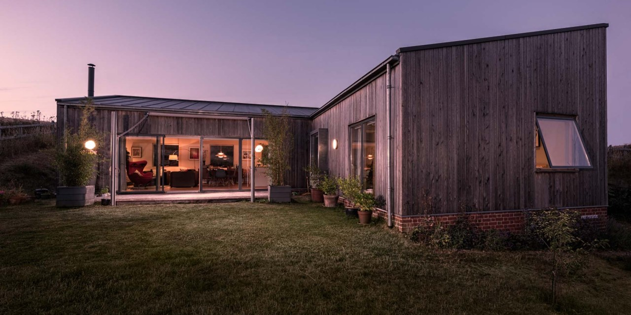 Creative commercial photography - Architectural Photography Joe Lenton twilight of larch clad bungalow