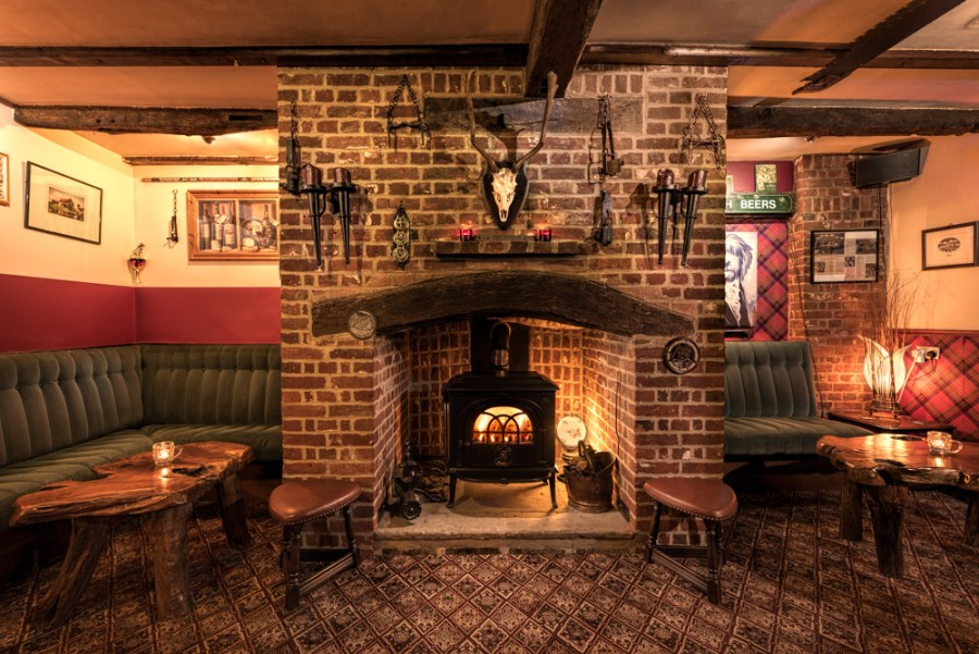 Showing the feel of a space - warm cosy pub interior with fireplace