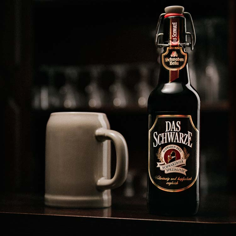Das Schwarze beer bottle next to German style Krug