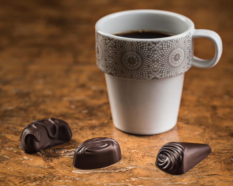 Chocolates with cup of coffee