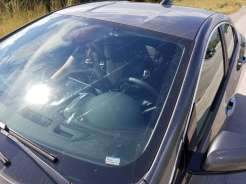 Damage to the windshield, roof, driver side front door, and (not pictured) driver side rear door.