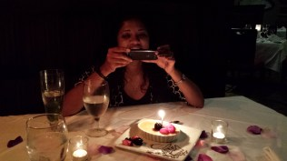 Taking a photo of our dessert