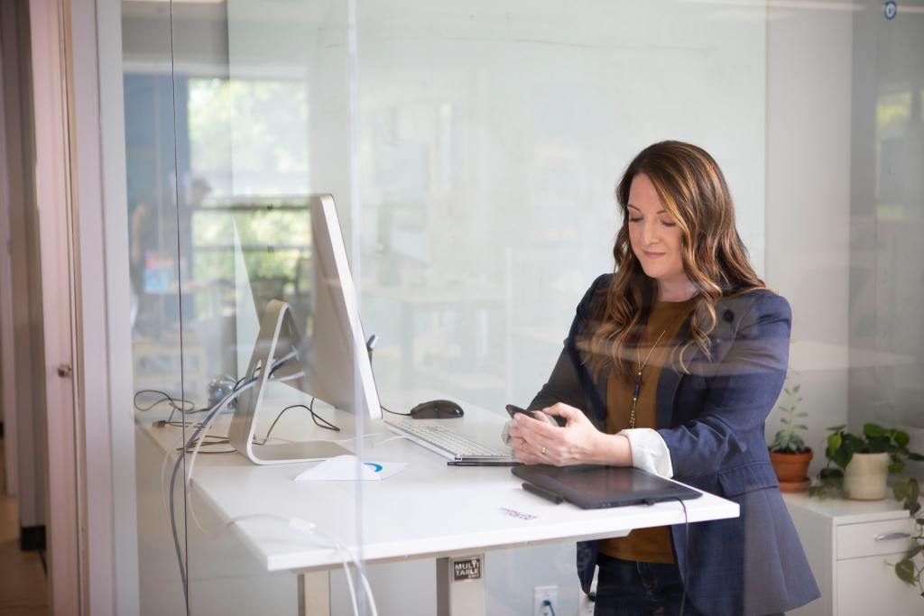 Woman in leather jacket using MacBook Air