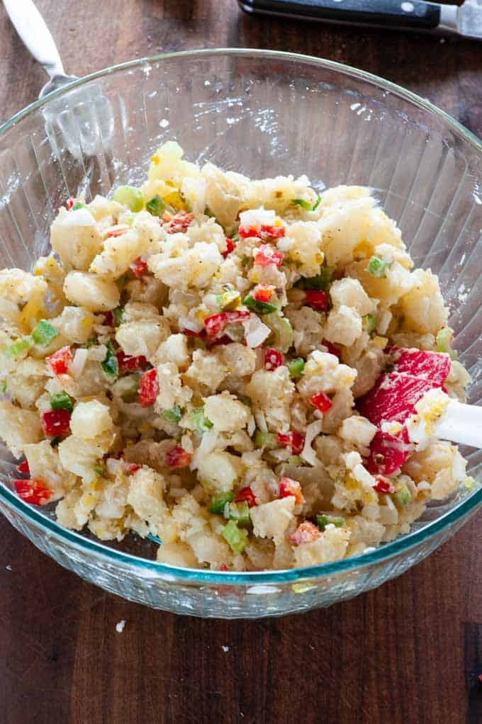 Mixing the potato salad.
