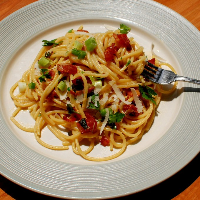 Spaghetti carbonara ready to eat with some grated parmesan. | joeshealthymeals.com