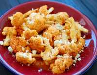 Roasted Cauliflower in Buffalo Sauce - sprinkled with crumbled blue cheese. What a delicious treat!   joeshealthymeals.com
