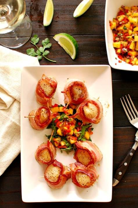 Scallops wrapped in bacon. Make a spicy mango salsa to go along with your scallops. This is a great appetizer recipe or also a main course. | joeshealthymeals.com