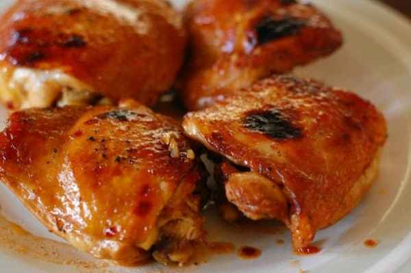 Honey glazed chicken thighs. Right out of the oven and ready for the delicious sauce for a topping. This chicken is better than you'll get at a restaurant! | joeshealthymeals.com