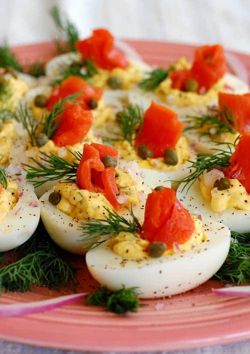 Lox deviled eggs. This is a delicious twist to traditional deviled eggs. The recipe has plenty of smoked salmon flavor, combined with salty capers and tangy red onion. With cream cheese and fresh dill, it is yummy! | joeshealthymeals.com