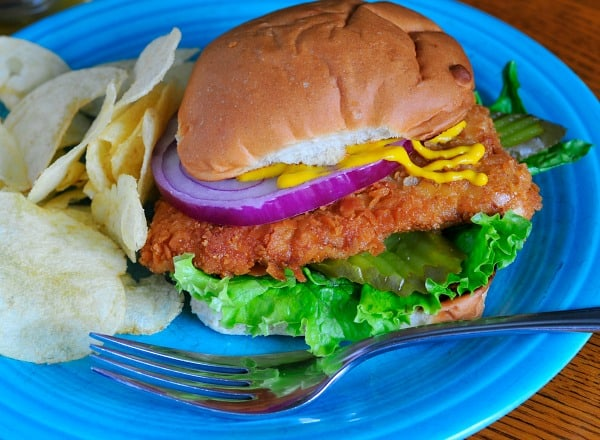 Breaded pork tenderloin sandwich. Deliciously crunchy cracker crumb breaded pork, just like I remember when I was a child. Yum! | joeshealthymeals.com
