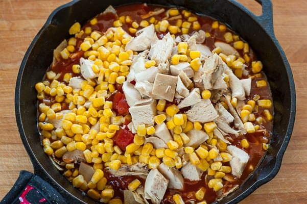 Chicken and corn in the skillet.