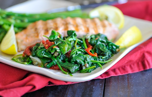 Wilted spinach with sun dried tomatoes and capers. Recipe for good eats and a 15 minute meal.   joeshealthymeals.com