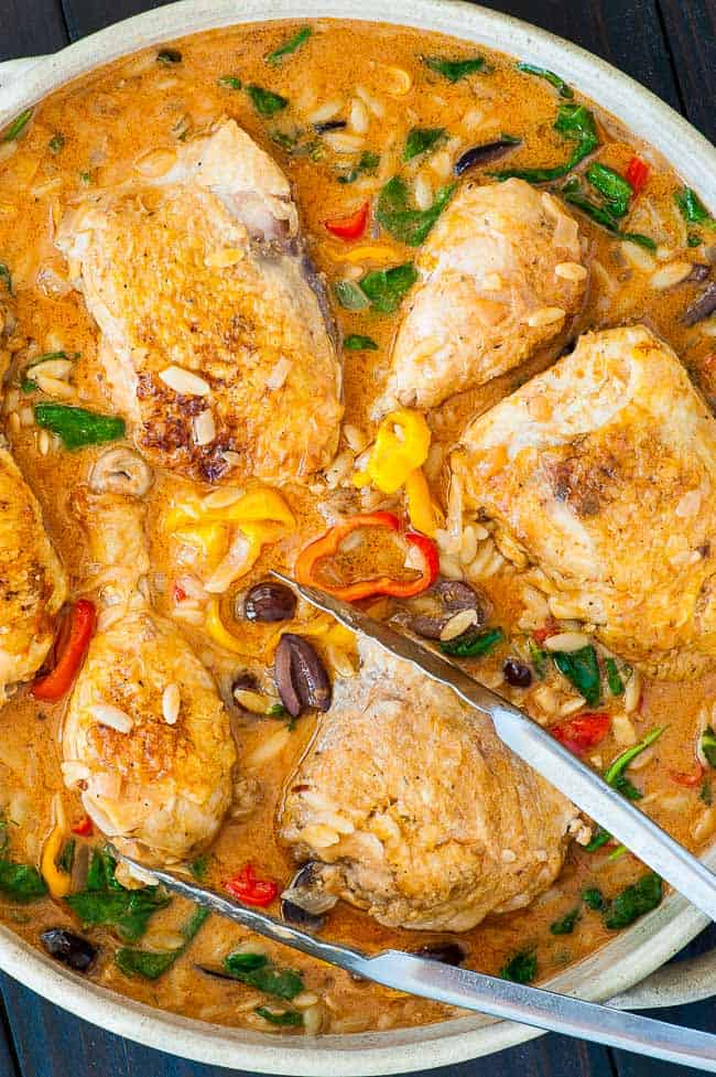 Crock Pot chicken with orzo and kalamata olives. Super moist, falling off the bone delicious chicken with creamy orzo and vegetables. | joeshealthymeals.com