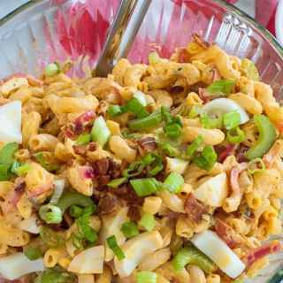 Macaroni deviled egg salad in a bowl. Delicious salad that everyone will love. Its deviled eggs in a bowl. | joeshealthymeals.com