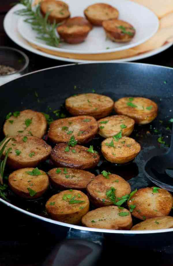 Pan braised baby potatoes with rosemary with garlic. Less than 30 minutes for a pan braised potato side dish. Easy and yummy. | joeshealthymeals.com