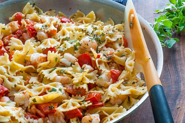 Pasta with roma tomatoes and shrimp sauce. Delectably simple sauce with tons of flavor. | joeshealthymeals.com