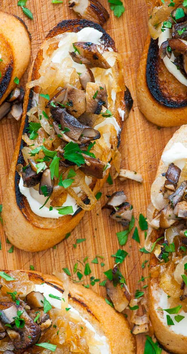 caramelized onion crostini. Caramelized onion crostini with mushrooms. Perfect appetizer for holidays, bowl games, NFL playoffs and the Super Bowl.   joeshealthymeals.com