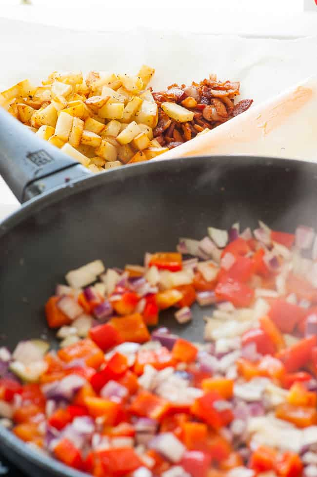 Sauteing red pepper and onions for breakfast hash.