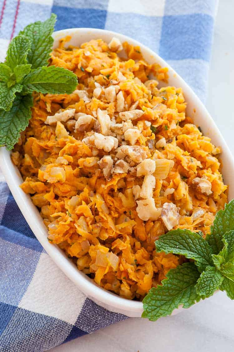 Sauteed shredded sweet potatoes is a perfect side dish kicked up with onions and walnuts.   joeshealthymeals.com