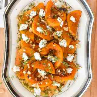 Roasted butternut squash, with goat cheese, maple syrup, and toasted walnuts.
