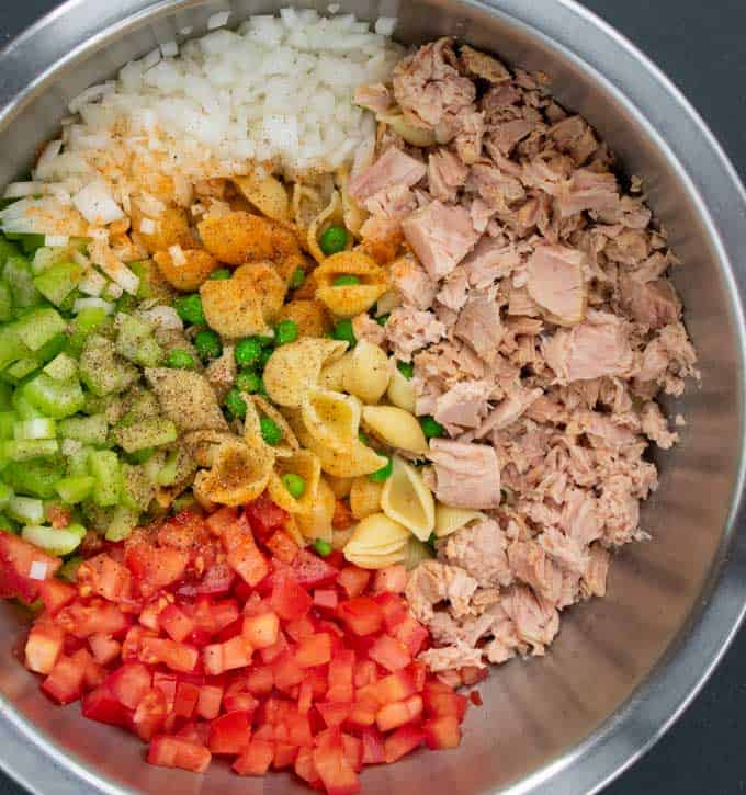 Cold tuna salad ingredients in a mixing bowl.