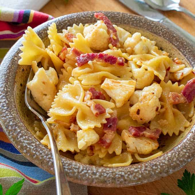 Bowl of pasta with cauliflower and pancetta.