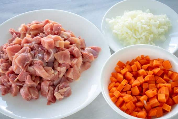 chopped chicken thighs, onions and carrots